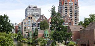 Foto bij onderzoek Woonbeleid in Zaanstad. Uitzicht op gebouwen in Zaanstad